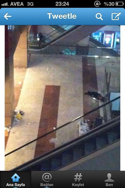 Ankara hit hard: A man lies on the floor in a shopping mall waiting for an ambulence