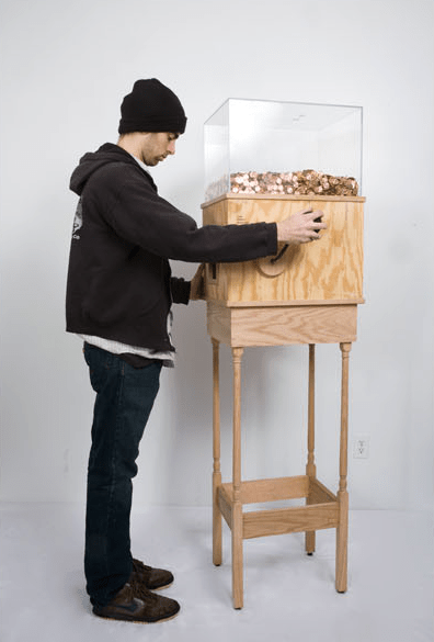 "Blake Fall-Conroy, ""Minimum Wage Machine,"" 2008-2010. This machine allows anyone to work for minimum wage for as long as they like.  Turning the crank on the side releases one penny every 4.97 seconds, for a total of $7.25 per hour.  This corresponds to minimum wage for a person in New York. This piece is brilliant on multiple levels, particularly as social commentary.  Without a doubt, most people who started operating the machine for fun would quickly grow disheartened and stop when realizing just how little they're earning by turning this mindless crank.  A person would then conceivably realize that this is what nearly two million people in the United States do every day…at much harder jobs than turning a crank.  This turns the piece into a simple, yet effective argument for raising the minimum wage. Here's a piece that another artist is working on that could also help inspire change in the U.S. government.  He's trying to raise money to send every U.S. Senator a copy of Dr. Seuss' ""The Zax.""  They clearly should have paid more attention to stories about compromise like this in kindergarten.  Indiegogo.com/TheZaxProject."
