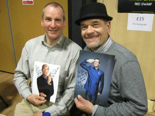 Chris Barrie and Robert Picardo holding signed promo pics of each other as their holographic character.  The photo of Robert Picardo has had a very obvious H added to its forehead.