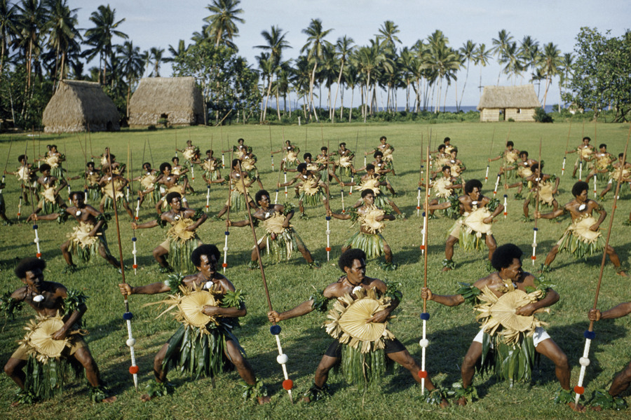 Dancing men brandish spears and palm-leaf shields in Fiji, November 1958.Photograph by Luis Marden, National Geographic