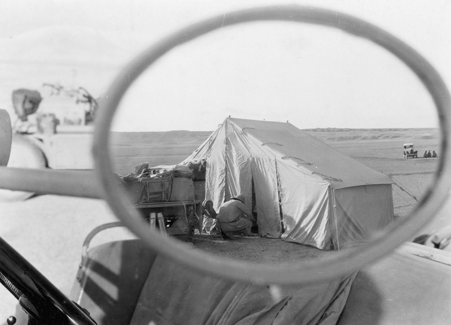 Rear view mirror glimpse of Euphrates camp near Marl Cliffs, Iraq.Photograph by Maynard Owen Williams, National Geographic