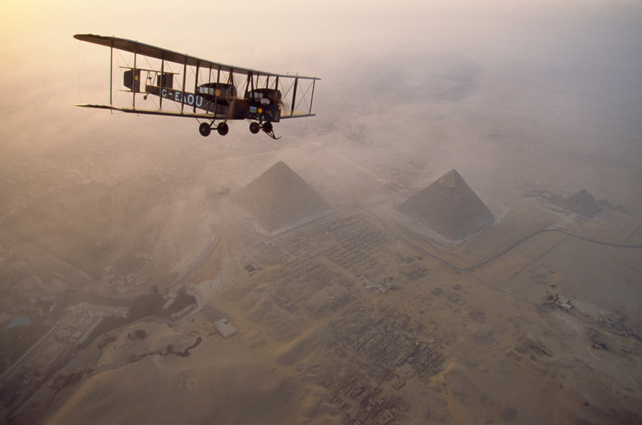In the light of early morning, the Vimy circles the pyramids at Giza on a dawn tour, May 1995.Photograph by James L. Stanfield, National Geographic