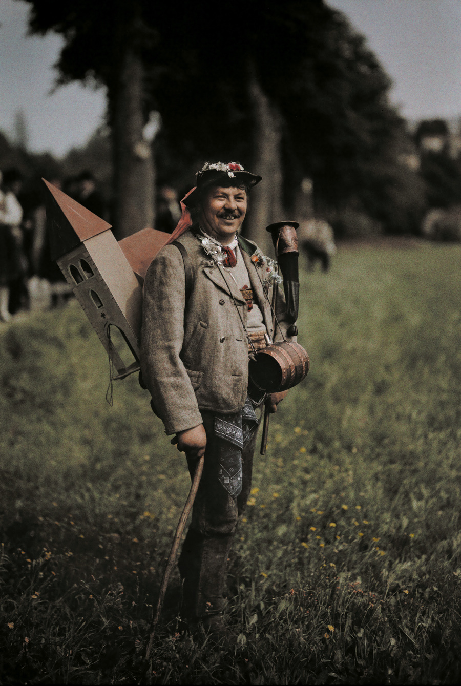 Peasant takes up collection for new church donning keg and cow horn in Austria, November 1932.Photograph by Hans Hildenbrand, National Geographic