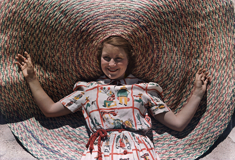 A girl wears a novelty braided Texas straw hat, October 1939.Photograph by Luis Marden, National Geographic