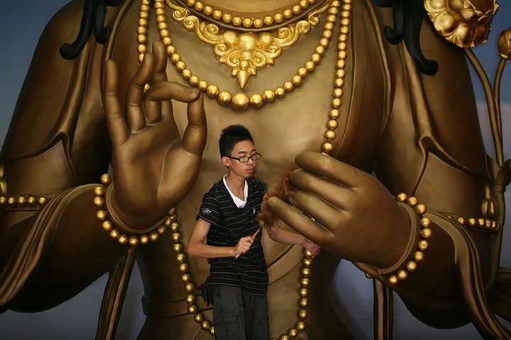 Medan, Indonesia: A statue in Satya Buddha Temple is cleaned in preparation for the Lunar New Year celebrationsPhotograph: Binsar Bakkara/AP