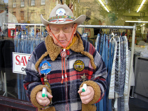 "Cowboy Joe is an old guy who wears a cowboy outfit and looks a bit like the loveable guy from The Benny Hill Show.  He can regularly be seen roaming the streets around the Grassmarket  area of Edinburgh and will draw his replica ""guns"" if challenged."