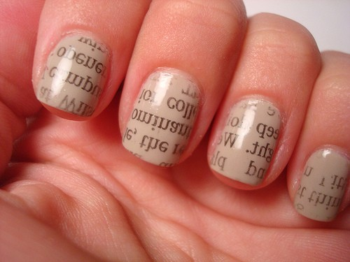 How to do this;1. Paint your nails any colour you'd like & LET THEM DRY.2. You will need rubbing alcohol & newspaper3. Cut out a little section of the newspaper & place it on your nail4. Put rubbing alcohol on a cotton ball and dab it over the newspaper5. THERE YOU GO :)
