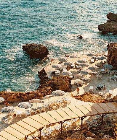 Cliff Side Beach, Positano, Italy photo via natalienewell