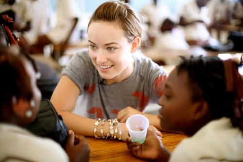 Olivia Wilde rocking a Kado necklace as a bracelet in Haiti