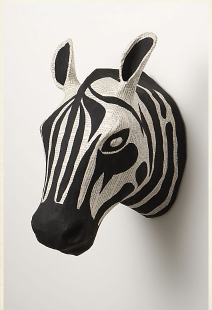 Savannah Story Bust has created these very cool papier mache animal heads as wall decor for a child's play room or living room area. <br /><br /><br /><br /><br /> — $68 each<br /><br /><br /><br /><br /> For further info check out: http://www.anthropologie.com/anthro/product/home-wall/970121.jsp