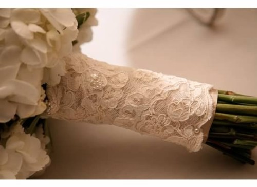 Wrap lace from your mother's wedding dress around the bouquet…Something borrowed