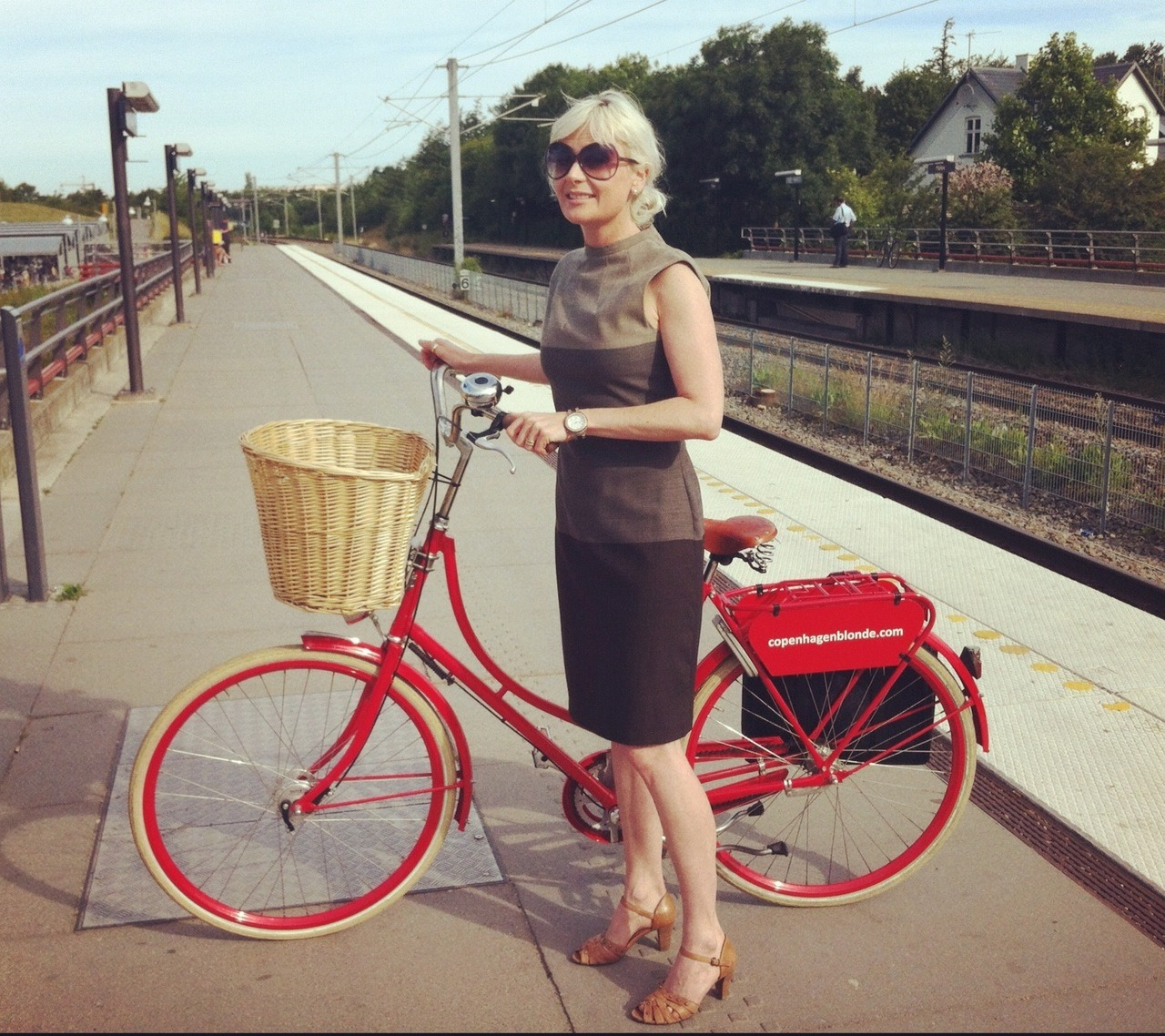"AG Go-Go, 41 year old, sends her greetings from the City of Cyclists, Copenhagen. Copenhagen, Denmark Why do you ride? I ride because of two reasons: 1. Transport - brings me fast, comfortably and fashionably:) to the train station (5 minutes from where I live) - and 2. exercise; a couple of times a week I ride all the way to my job (on my sportsbike) - which is 13 miles . Great for abs and thighs! Best thing about cycling? It's on my terms, don't need to be stuck in traffic jam like when driving a car. And it makes my brain work well, coming up with new ideas when moving my body to the cycle rhythm. What improvements would you like to see for cyclists? More green routes! Away from the car traffic. However, I think Copenhagen is a great city for cyclists - I love it! Fondest cycling memory? I don't have a specific experience, it's more sort of the great comfort of riding my new red Velorbis bike. In cycle language it must be like driving a limo. Cycling tip? If you do bicycle a lot, do yourself the favor of spoiling yourself with a chic and comfortable bike. It makes bicycling so much more fun. And yes, remember a solid lock! 3 things you'd love the world to know about you? - My mantra is ""celebrate life - celebrate yourself!"" - I may seem a bit superficial and ""too positive"", but I'm not (superficial) - I've been through hard times, and the strategy the rest of my life is to focus on love and possibilities. - My blog is www.copenhagenblonde.com"
