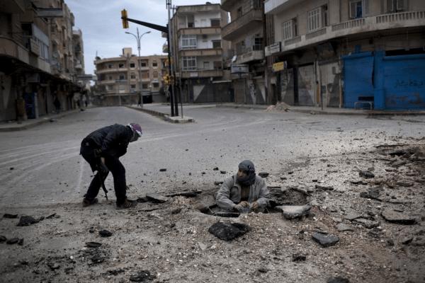 Members of the Syrian opposition placing an I.E.D. (Rodrigo Abd, Associated Press).
