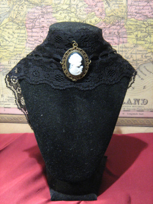 17 inches / 43 centimetre black lace ribbon choker, 2 3/4 inches 6.5 centimetres wide, two-popper closure, with brass frame and resin cameo. Delicate lacy Victorian mourning choker perfect for goths, lolitas, cosplay, or just adding a little old-time style to an outfit. Wear it over a high-necked top, or on bare skin!REDUCED from £15.00