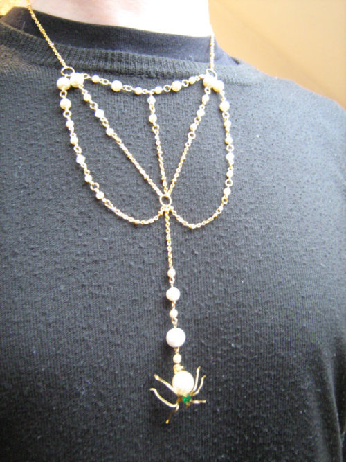 19 inch / 48 centimetre gold plate chain, acrylic bead, glass pearl necklace with vintage glass pearl accents and vintage pearl and green paste gem spider pendant.Have you ever seen a spider web holding the morning dew? Now everyone who passes you will get the benefit of that beautiful experience too!REDUCED from £17.99