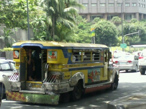 The famous Jeepneys. People hop on and off. It gets extremely crowded, sometimes some are forced to almost hang off the back or side.