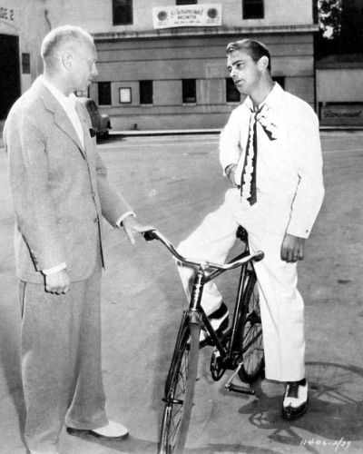 Director John Farrow talks to Alan Ladd during the making of Calcutta