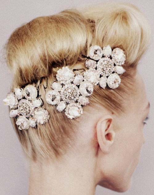 Why don't you …<br />Collect rhinestone brooches at the flea market and pin them in your hair for holiday parties?<br />Image: Chanel Haute Couture (Spring 2008)