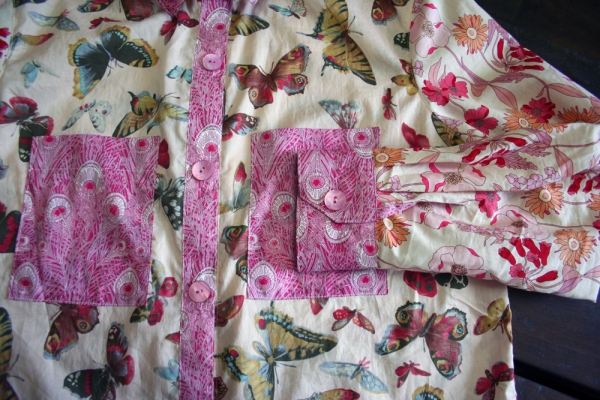 A beautiful Liberty Tana Lawn Hera in pink for the button band, cuffs & plackets, upper collar, and yoke.