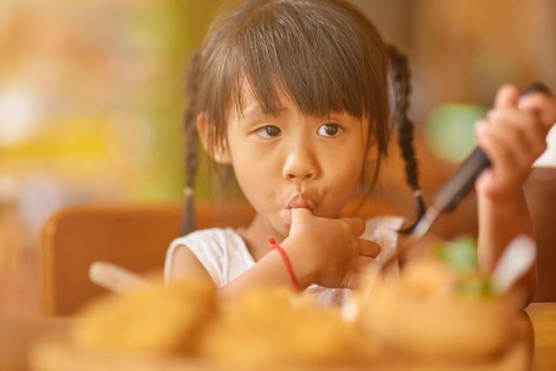 Little thai girl enjoying her meal