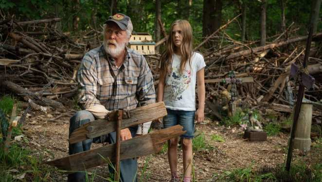 Jud (John Lithgow) takes Ellie (Jete Laurence) on a tour through the infamous Pet Sematary.