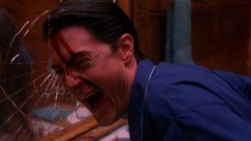 Dale Cooper smashes his head against a mirror and laughs