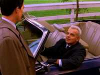Leland Palmer pulls up in his car alongside Agent Dale Cooper