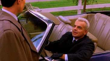 Leland Palmer pulls up in his car alongside Agent Dale Cooper