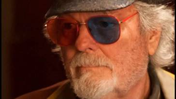 Dr Jacoby wearing red and blue lens glasses