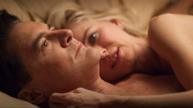 Cooper and Janey-E lie in bed together cuddling after sex