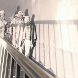 Woodsmen stood on a staircase in Twin Peaks