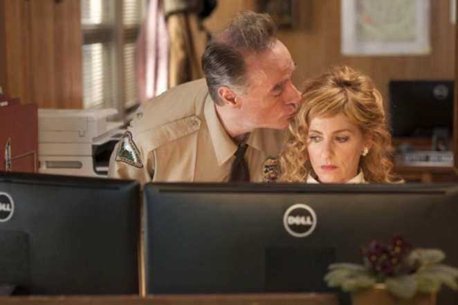 Andy kisses lucy on the head at the twin peaks sheriffs station