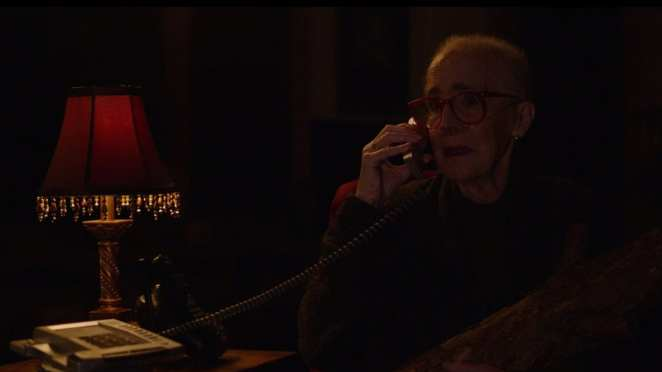 Catherine Coulson as the log lady on the telephone