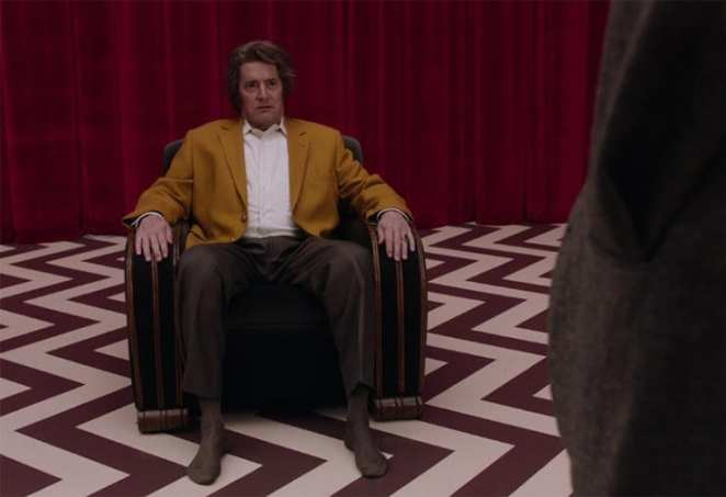Dougie Jones, a man who looks like agent cooper sits in a chair in the red room