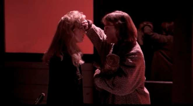 the log lady touches the forehead of Laura Palmer out of concern