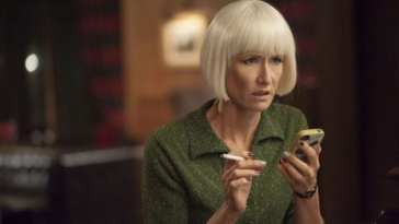Diane looks scared after reading a text message