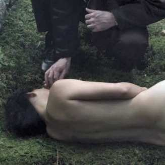 naido lies naked on the ground in twin peaks