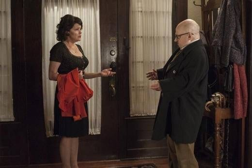 Audrey and Charlie argue as they stand in the threshold of their home