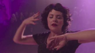 Audrey Horne dancing in purple light