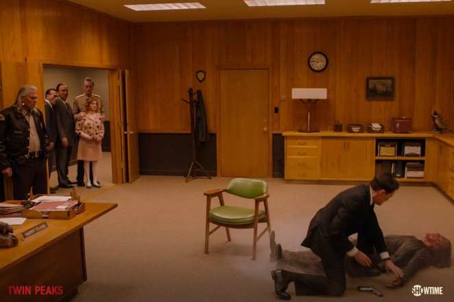 Agent cooper checks the body of Mr C as Hawk, Lucy, Andy and the Mitchum brothers look on