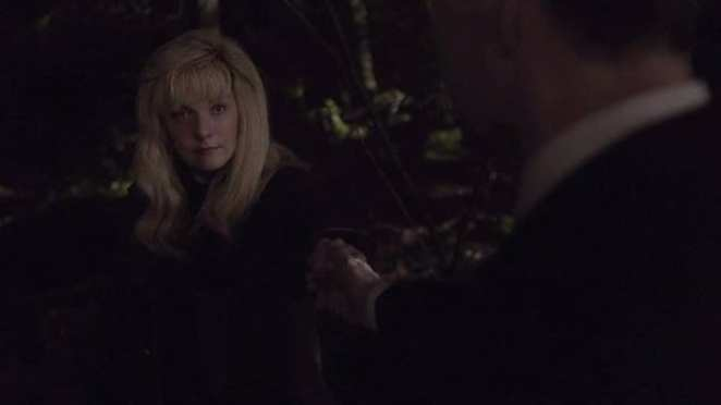 Laura Palmer takes the hand of Agent Cooper
