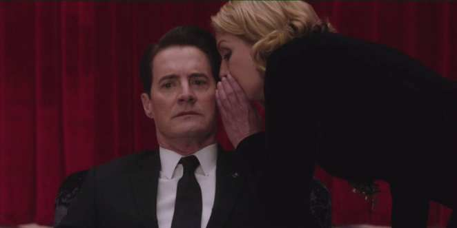 Laura Palmer whispers in the ear of dale cooper in the red room