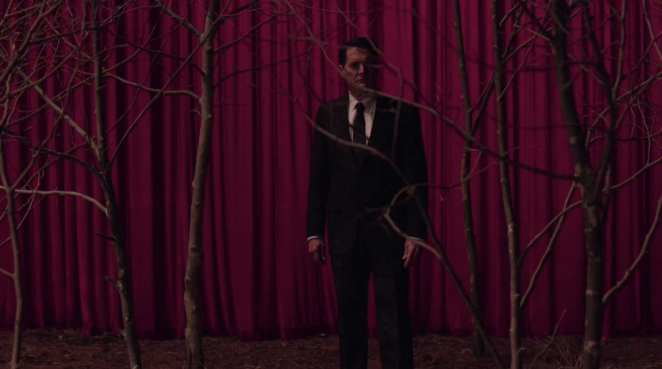 dale cooper leaves the red room through curtains and stands in the circle of sycamore trees
