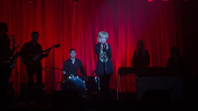 singer julee cruise appears in front of the roadhouse red curtain in 2017s Twin Peaks