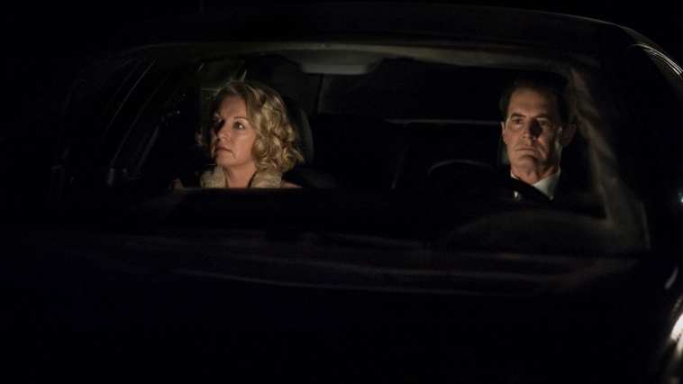 Cooper and Carrie ride in a car together at night