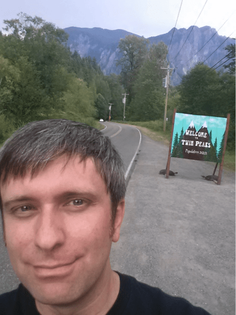 Ben at the Twin Peaks sign in North Bend