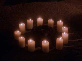 12 candles burning in a circle