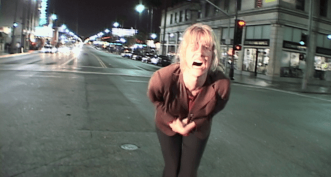 Nikki Grace in Inland Empire screaming in the street