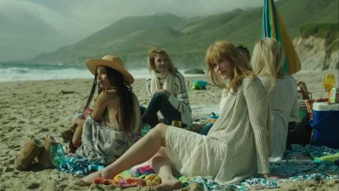 Laura Dern with Zoe Kravitz, Nicole Kidman and Reece Witherspoon sit on a beach in Big Little Lies