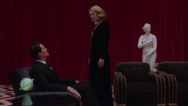 Laura Palmer approaches a seated Dale Cooper in the red room in Twin Peaks